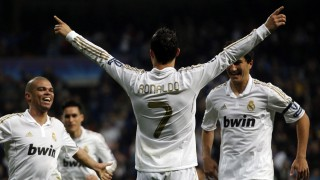 Real Madrid's Ronaldo celebrates a goal with Pepe and Sahin after scoring against APOEL during their Champions League quarter-final second leg soccer match in Madrid