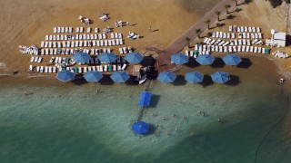 People sunbathe at a public beach in this aerial view of the Dead Sea