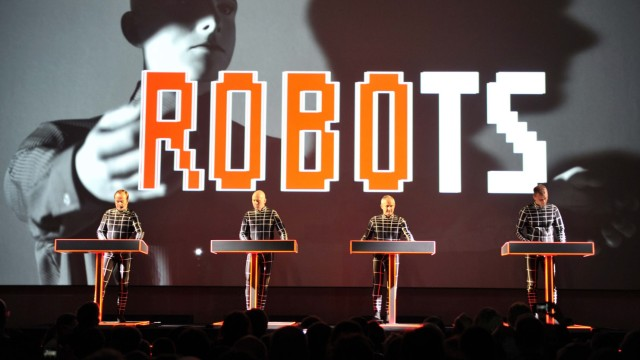 German electronic music band Kraftwerk perform their song 'The Robots' during the Kraftwerk - Retrospective 1 2 3 4 5 6 7 8 performance at the Museum of Modern Art in New York