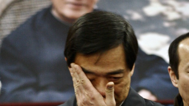 China's former Chongqing Municipality Communist Party Secretary Bo Xilai wipes his tears at a mourning hall held for his father Bo Yibo in Beijing