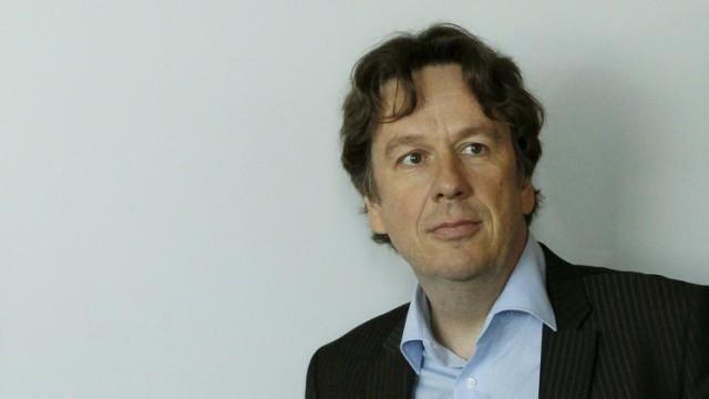 Swiss meteorologist and TV weather host Kachelmann awaits a news conference in Zurich