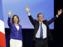 Hollande, Socialist Party candidate for the 2012 French presidential election, arrives with Segolene Royal in Rennes