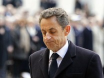 France's President Sarkozy pays respect to World War II French resistance fighter Aubrac in the courtyard of the Invalides in Paris