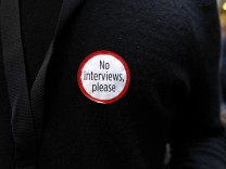 A survivor of the Utoeya island massacre of 2011 sports a sticker during a break outside the courtroom where Breivik stands trial in Oslo