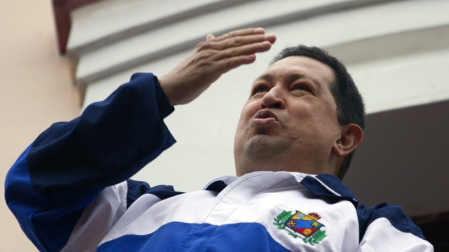 Venezuelan President Hugo Chavez blow a kiss from 'people's balcony' at Miraflores Palace in Caracas