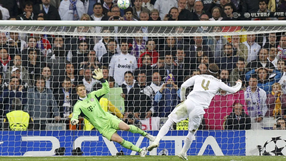 Real Madrid's Ramos takes a penalty kick and fails to score against Bayern Munich's goalkeeper Neuer during their Champions League semi-final second leg soccer match at Santiago Bernabeu stadium in Madrid