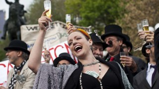 Occupy Wall Street demonstrators dressed to represent bankers participate in a street-theater production during a protest against the rising national student debt in Union Square, in New York