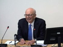 A still image from broadcast footage shows Rupert Murdoch speaking at the Leveson Inquiry at the High Court in London