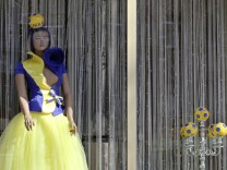 A mannequin decorated with Ukraine's national colors for the Euro 2012 soccer tournament is displayed in a show window in the Ukrainian Black Sea port of Odessa