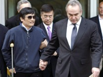 An handout photo shows blind activist Chen Guangcheng being accompanied by U.S. Assistant Secretary of State for East Asian and Pacific Affairs Kurt Campbell and U.S. Ambassador to China Gary Locke, in Beijing