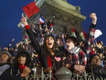 Supporters of Francois Hollande, Socialist Party candidate for the 2012 French presidential election, celebrate at a rally at Place de la Bastille in Paris