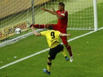 Borussia Dortmund's Lewandowski scores a goal next to Bayern Munich's Boateng during their German DFB Cup (DFB Pokal) final soccer match at the Olympic stadium in Berlin
