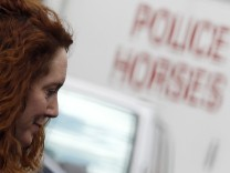 Former News International chief executive Rebekah Brooks leaves Lewisham police station in London