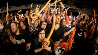 Supporters of the Pirate Party react after the first exit polls for the North Rhine-Westphalia federal state election in Duesseldorf