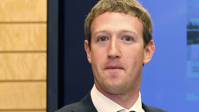 Facebook CEO Zuckerberg waits for Japanese PM Noda before a meeting at the latter's official residence in Tokyo