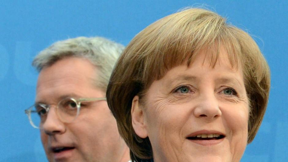 Kanzlerin Merkel und ihr bisheriger Umweltminister Röttgen.