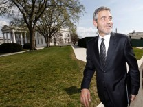 George Clooney departs the White House after his meeting with U.S. President Obama about Darfur in Washington