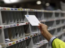 A Royal Mail employee sorts letters at the Royal Mail Mount Pleasant Sorting Office in London