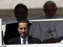 File photo of Pope's butler, Paolo Gabriele with Pope Benedict XVI at St. Peter's Square in Vatican
