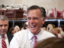 U.S. Republican presidential candidate Mitt Romney greets supporters during a campaign rally in Las Vegas