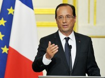 France's President Hollande speaks at a news conference at the Elysee Palace in Paris