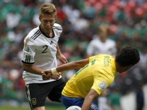 Germany's Mitchell Weiser battles Brazil's Emerson during their match for third place in the U-17 World Cup Mexico 2011 in Mexico City
