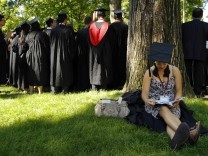 Graduating student Jennifer Lim sits in the shade at Harvard University in Cambridge