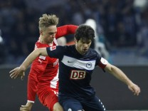 Ilso of Fortuna Duesseldorf fights for the ball with Lewan Kobiaschwili of Hertha Berlin during their Bundesliga first division relegation soccer match in Berlin