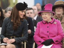 Britain's Queen Elizabeth and Catherine, Duchess of Cambridge watch a fashion show at De Montfort University during a visit to Leicester