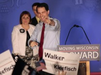 Republican Wisconsin Governor Walker celebrates his victory in the recall election against Democratic challenger and Milwaukee Mayor Barrett in Waukesha, Wisconsin