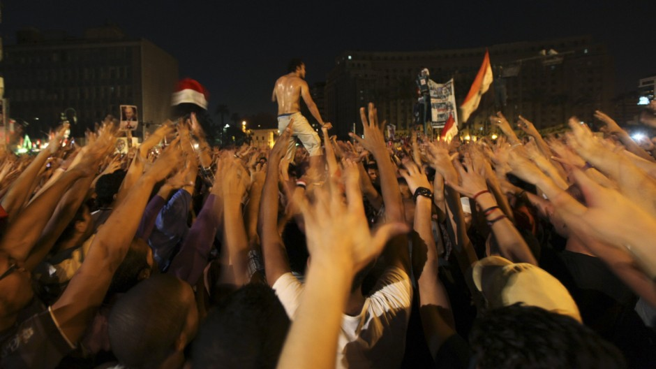 Ultras soccer fans shout slogans against the verdict for deposed leader Mubarak and against presidential candidate Shafiq during a demonstration in Cairo