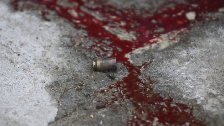A bullet shell is seen near blood at a crime scene in Emiliano Zapata neighborhood in Acapulco