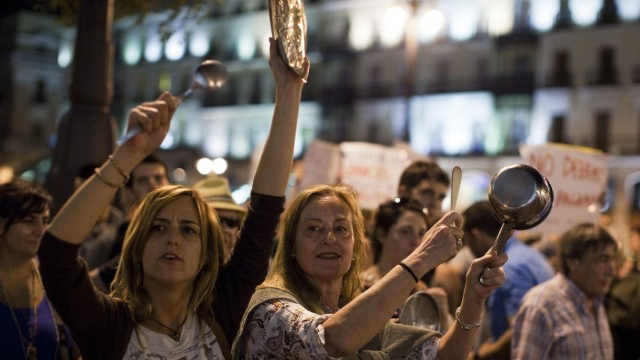 Demonstrators protest against Spain's bailout shout slogans in Puerta del Sol in Madrid