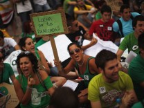 Students shout slogans at the end of a march at La Constitucion square in Malaga
