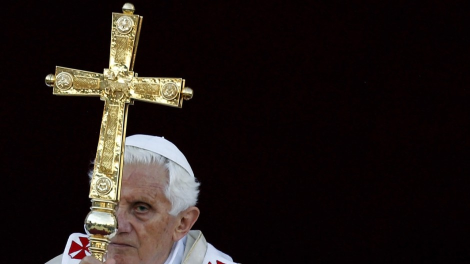 Pope Benedict XVI holds the cross as he leads the Corpus Domini mass in Rome's Basilica of St. John in Lateran