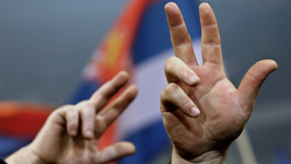 Supporters of the Serbia's ultra-nationalist Radical Party acting leader Tomislav Nikolic flash traditional three-finger signs during a final pre-election rally in Belgrade