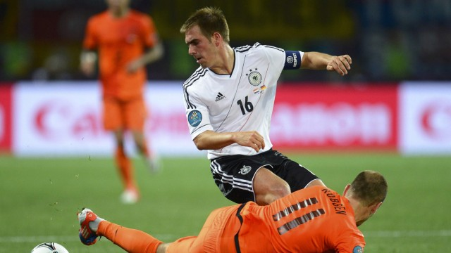 Netherlands' Robben challenges Germany's Lahm during their Group B Euro 2012 soccer match at the Metalist stadium in Kharkiv