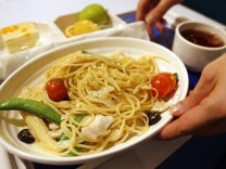 A waitress serves a meal inside the A380 In-flight Kitchen, a restaurant named after the giant Airbus airliner, in Taipei