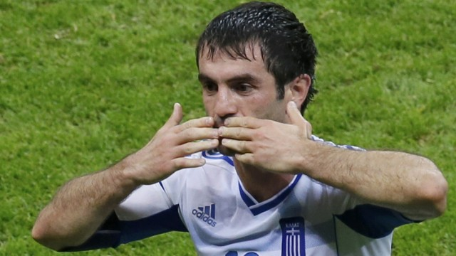Greece's Karagounis celebrates his goal against Russia during Euro 2012 soccer match in Warsaw