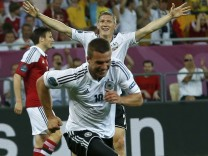 Germany's Schweinsteiger celebrates after his team mate Podolski scored a goal against Denmark during their Group B Euro 2012 soccer match at the New Lviv stadium in Lviv