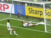 England's Terry clears  ball from goal mouth during Euro 2012 soccer match against Ukraine in Donetsk