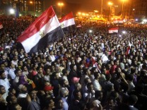 Protesters chant slogans against the military council at Tahrir Square in Cairo