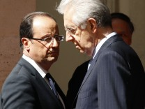 Italian PM Monti and French President Hollande are seen before a meeting at Chigi palace in Rome