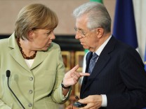 German Chancellor Merkel talks with Italian Prime Minister Monti prior to a news conference at Villa Madama in Rome