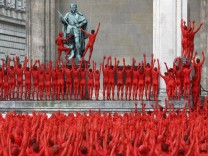 Naked volunteers pose for U.S. artist Spencer Tunick in downtown Munich