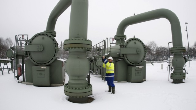 File photo of technician of RWE controling a compressor station in the western town of Huenxe