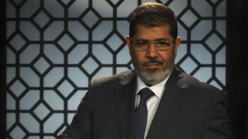 Egypt's President-elect Mohamed Mursi speaks during his first televised address to the nation at the Egyptian Television headquarters in Cairo