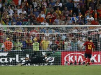 Spain's Fabregas scores a decisive penalty during penalty shoot-out of the Euro 2012 semi-final soccer match against Portugal at Donbass Arena in Donetsk