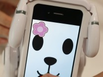 Japanese toymaker Bandai's 'Smart Pet' robotic dog toy is demonstrated at the International Toy Show in Tokyo