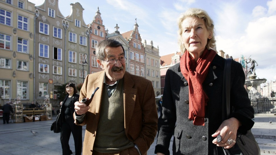 German novelist and winner of the Nobel Prize in Literature Guenter Grass and his wife Ute walk in the centre of Gdansk